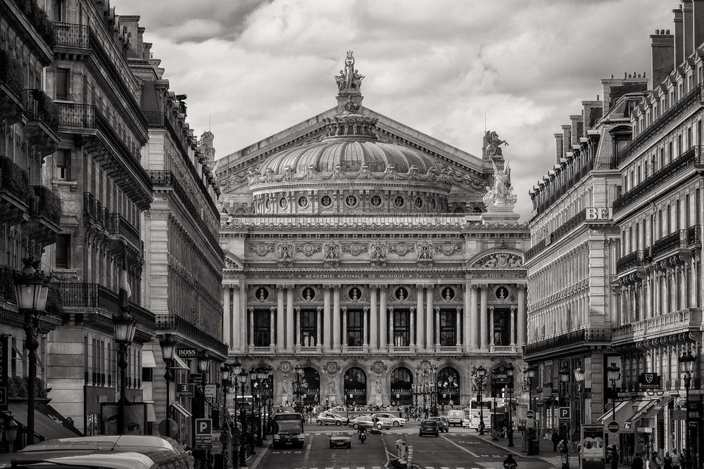 A contemporary black and white rendering of a    Paris street scene   , looking onto the    Academie Nationale De Musique   , evokes a sense of nostalgia in one of the world's most beautiful cities.