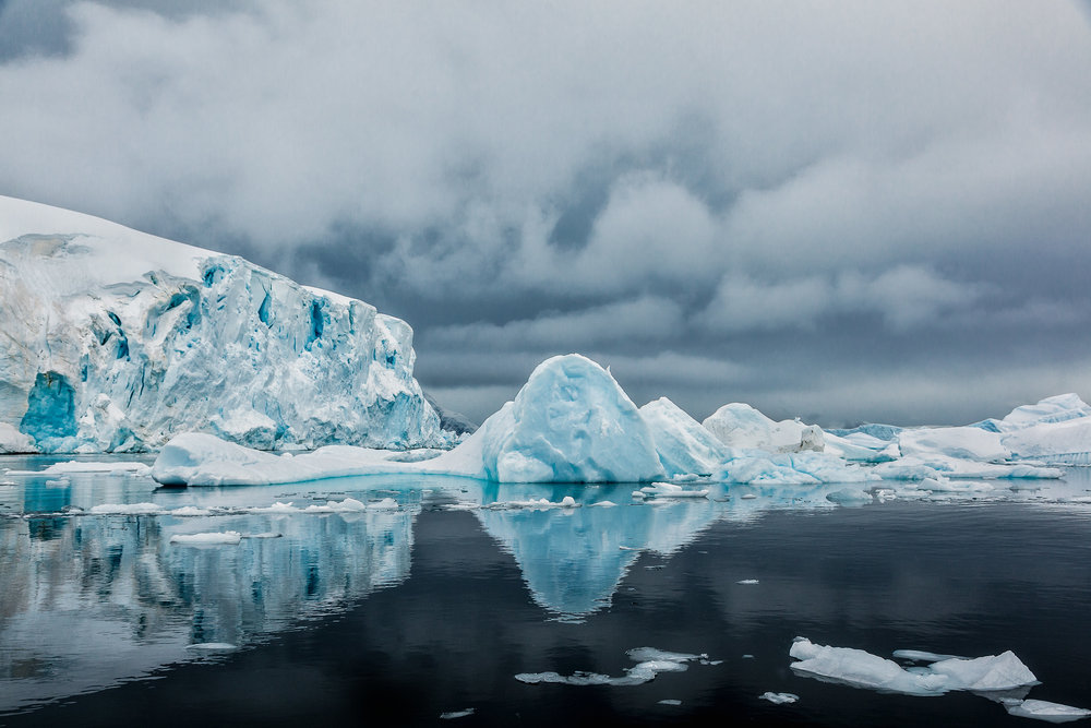 A spectacular zodiac cruise on tranquil waters around Cuverville Island, Antarctica.