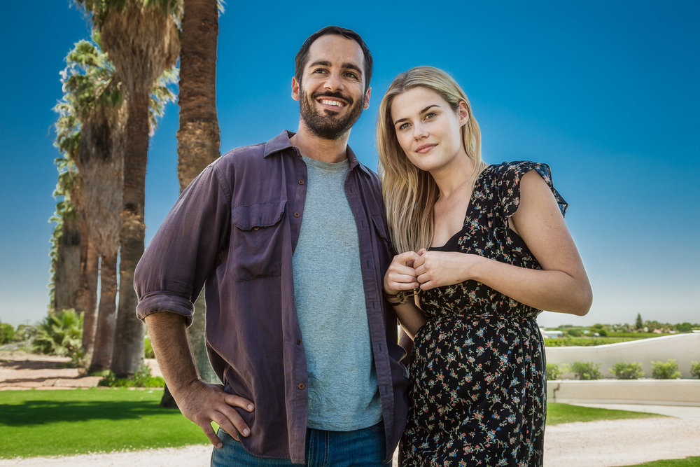 Rachel Taylor  and  Alex Dimitriades  in front of palm trees under a hot summer sun near  Mildura, Australia .