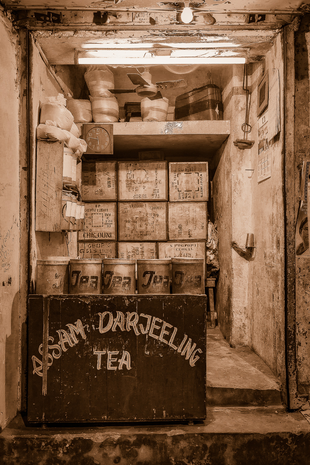 A    nostalgic view    of a    tea store    displaying    Assam Darjeeling Tea    in a street market in    Kolkata, India   .