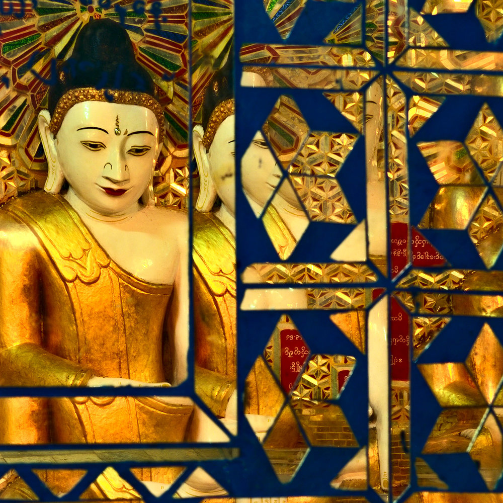 Reflections of a beautiful Buddha statue on Saiging Hill, Myanmar.