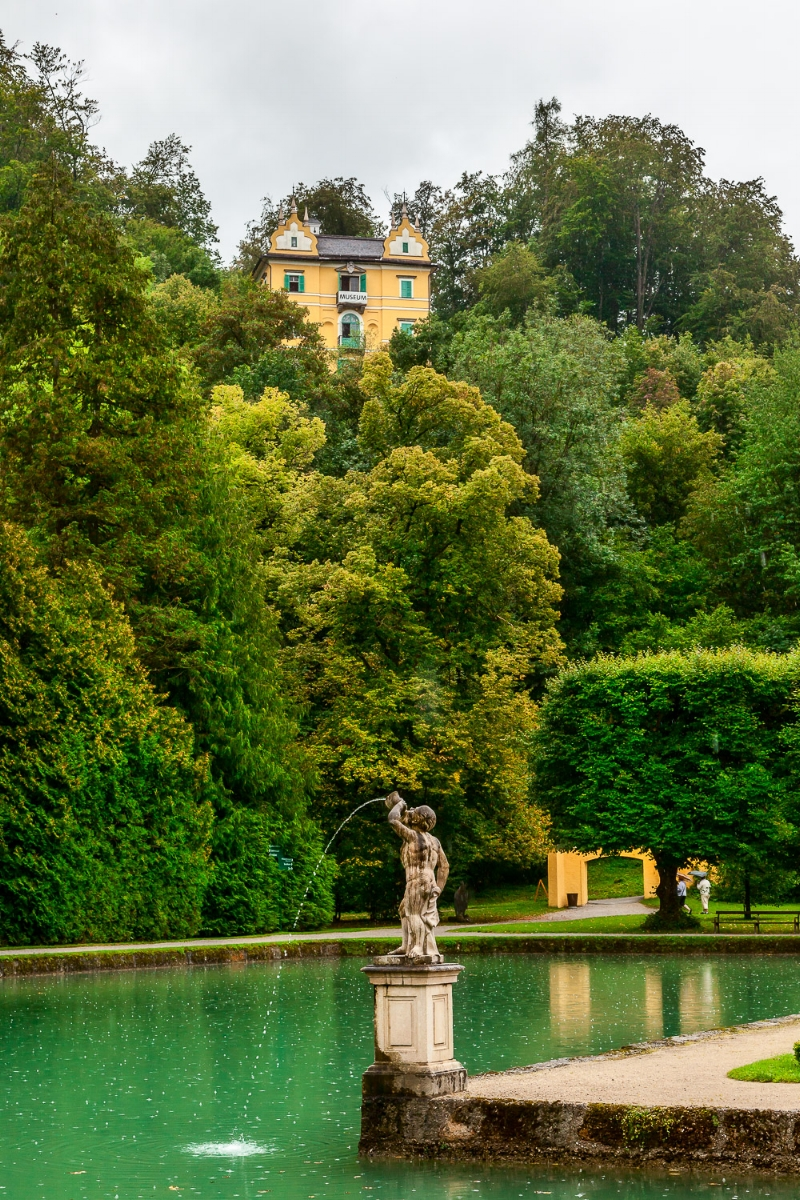 A statue spouting water in an incredibly tranquil park in Salzburg, Austria.