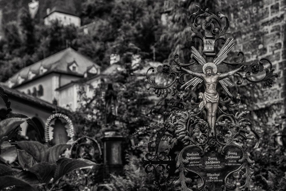 Crucifix in the grounds of the historic St. Peter's Cemetery in Salzburg, Austria.