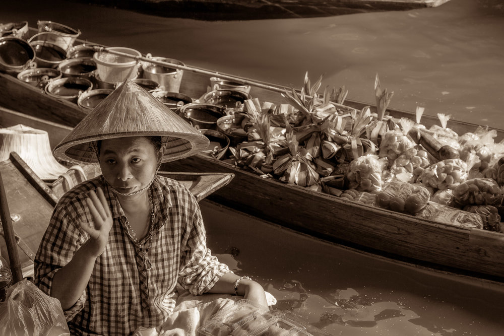 A  woman selling her produce  from a canoe at the  Floating Markets  near  Bangkok  in  Thailand .