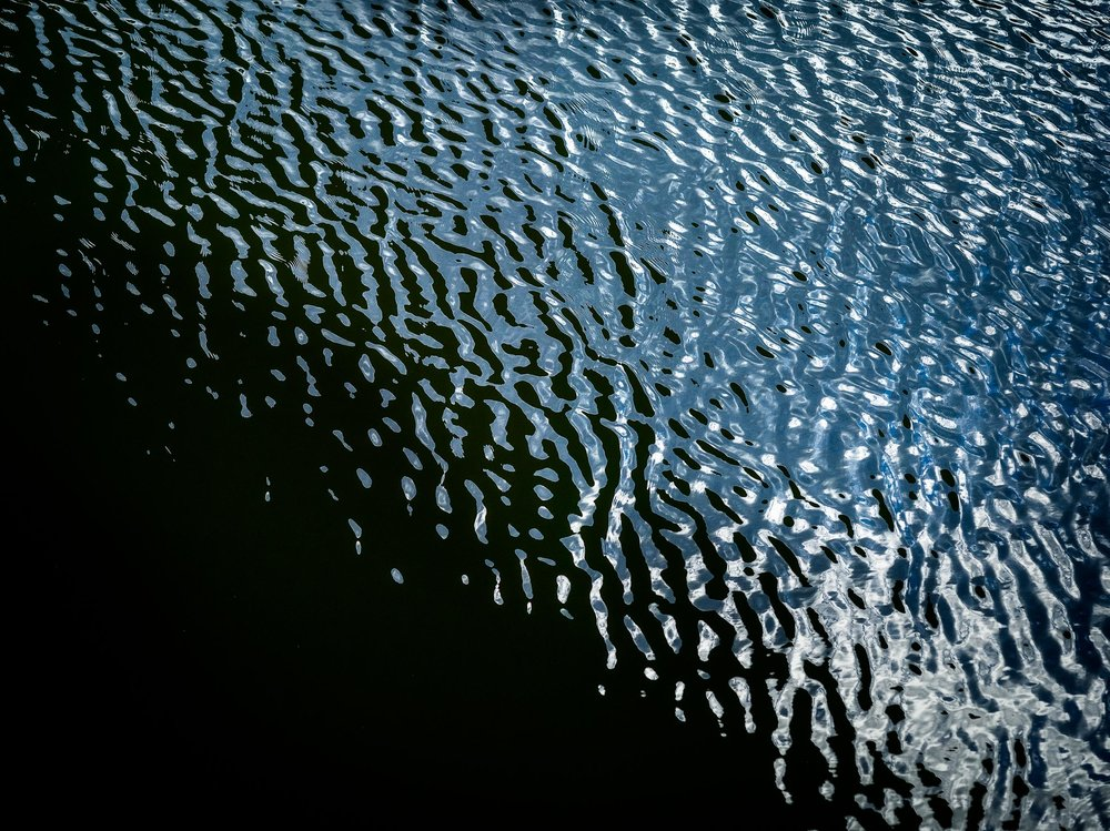 Ripples and patterns  on the  surface of a lake  make for an interesting image.