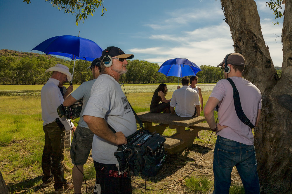 Behind the scenes view of a  film crew  at the  Abangbang Billabong  in  Kakadu National Park, Australia .