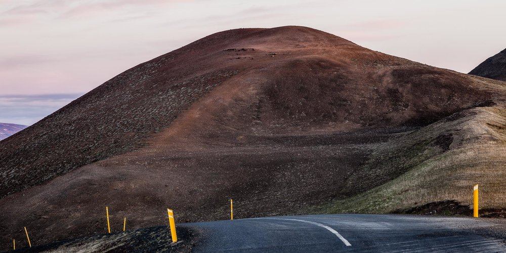 A spectacular drive, along a sealed road, at the top of a mountain pass near Myvatn in northern Iceland.