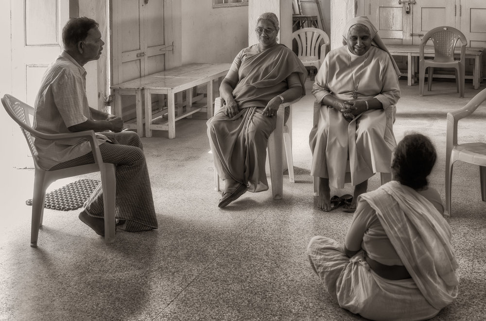 A  casual conversation  in the multi-purpose hall in the  village of Maria Purem (a village named after by mother ) near  Chennai, India