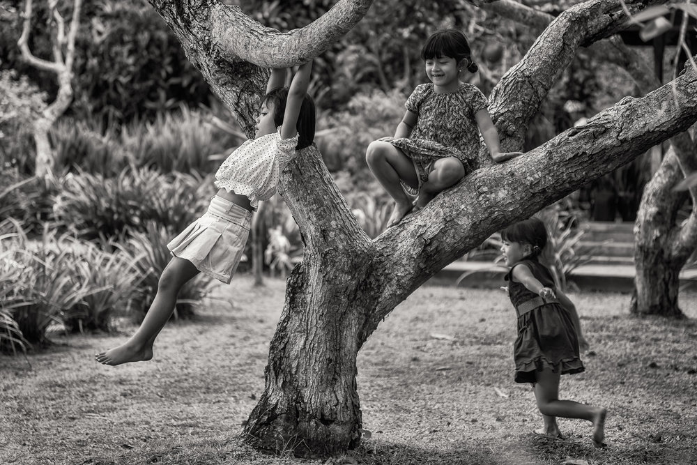 Three young girls at play  in the grounds of a  Hindu Temple  complex in  Bali, Indonesia .