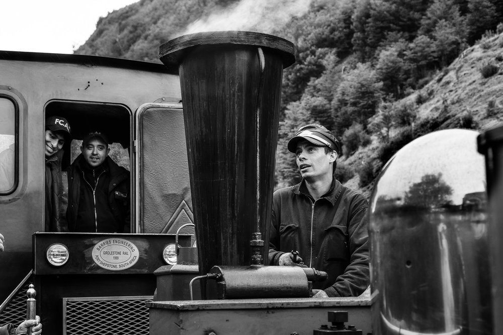 An  engineer  tinkering with his pride, a lovely  steam train  in the  Tierra del Fuego National Park ,  Argentina .