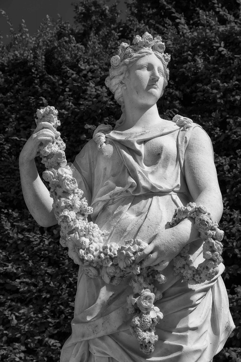 Statue and wreath in the grounds of the Palace of Versailles, France