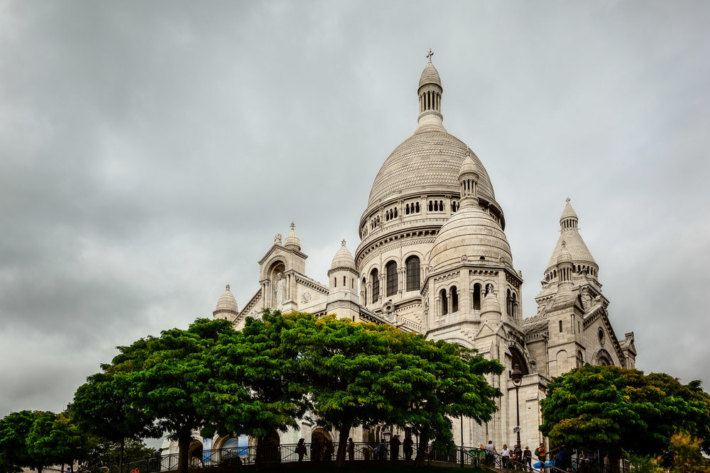 An upward view of the beautiful Sacre Coeur Basilica in Montmarte in Paris, France.