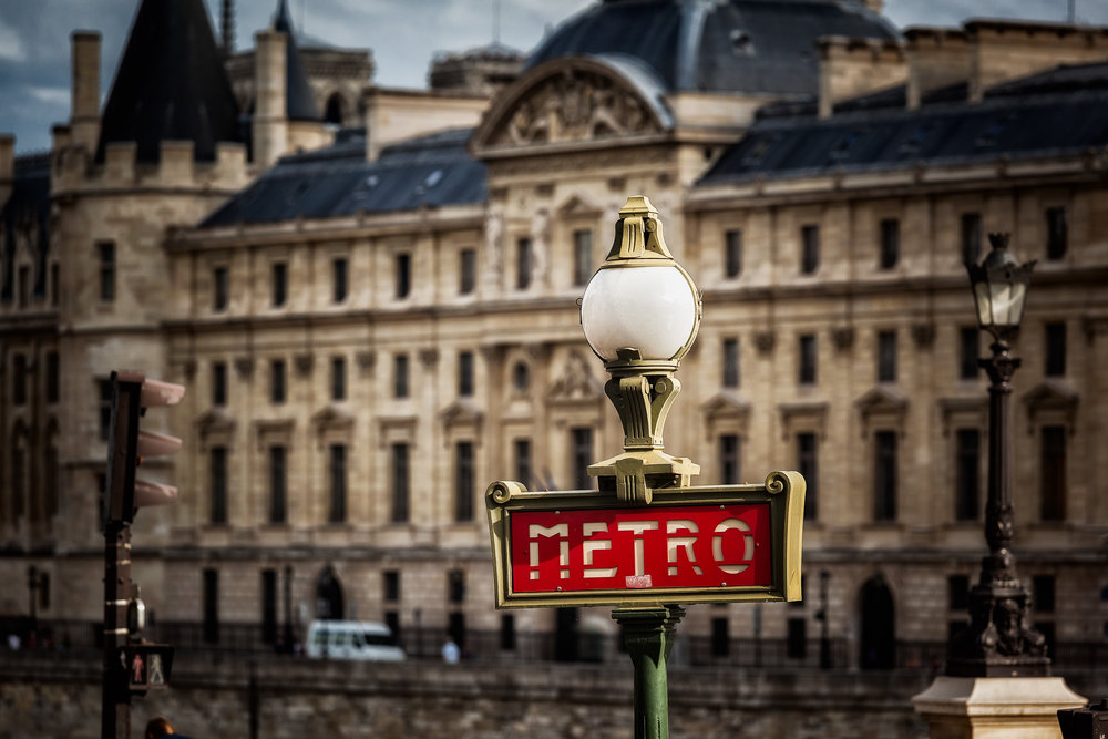 A detailed view of    Paris    expressed through this    Metro sign   .