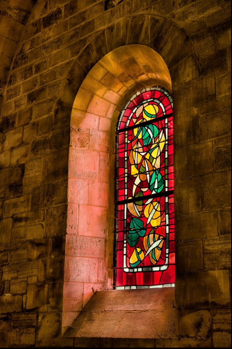 Stained glass window  in a  small chapel  next to the  Sacre Coeur Basilica  in  Paris, France .
