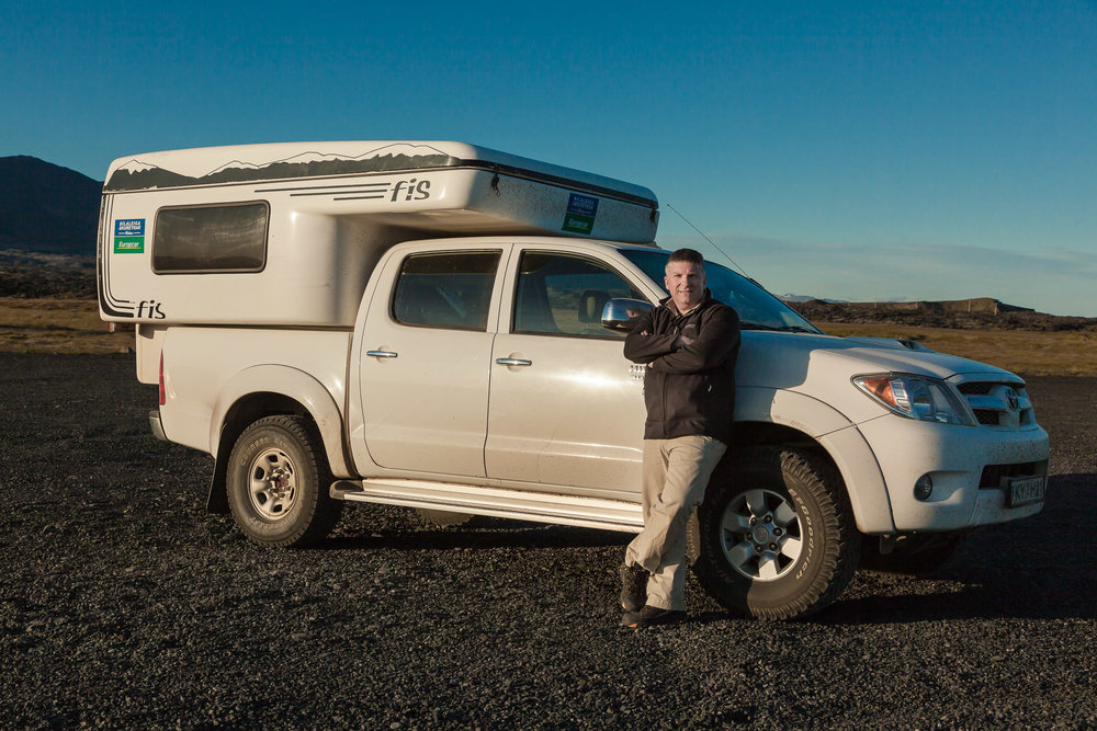 That's me,  Glenn Guy , the  Travel Photography Guru , pictured with  camper van  while on tour in  Iceland .