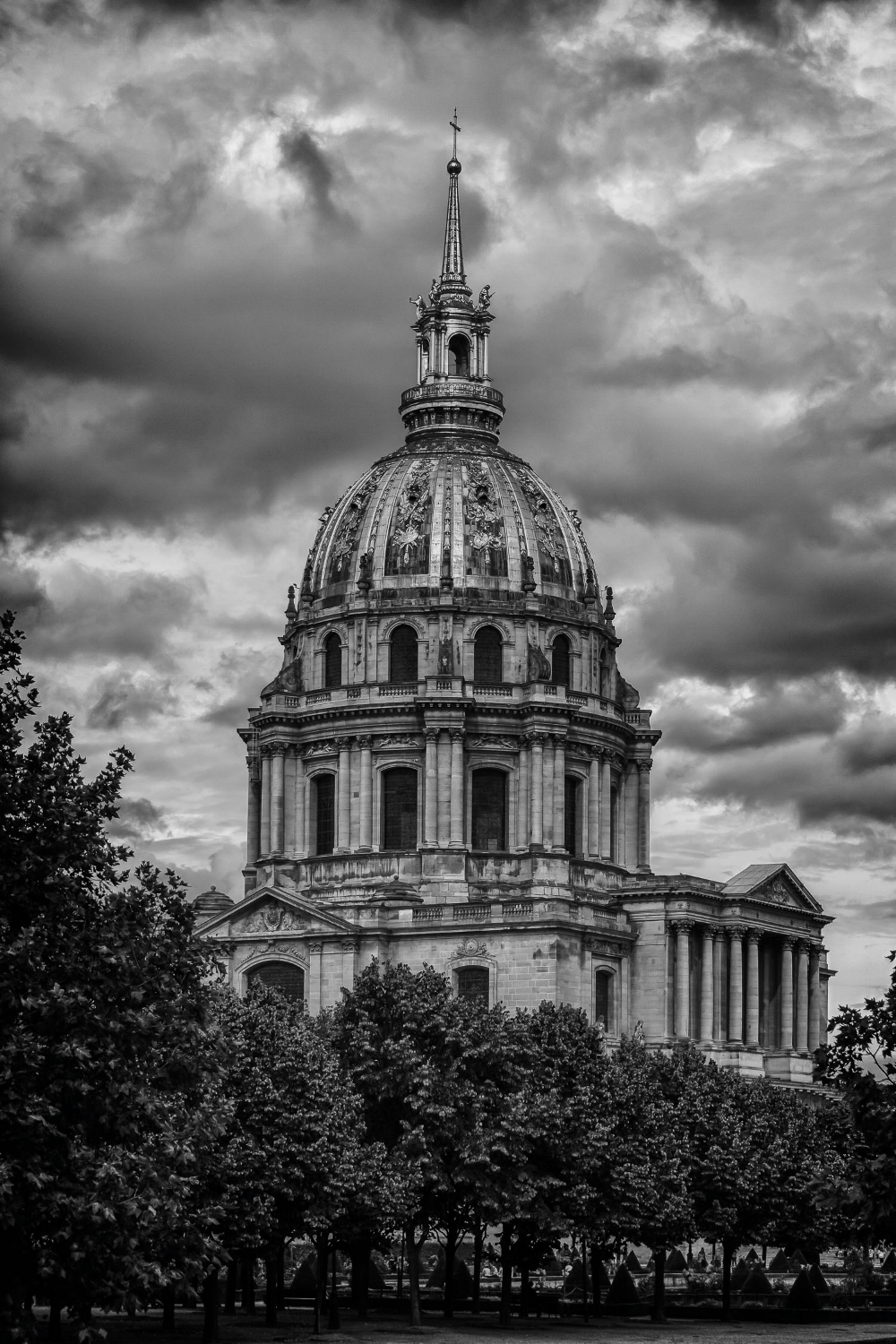 An exterior black and white rendering of Les Invalides pictured against a dramatic sky in Paris, France.