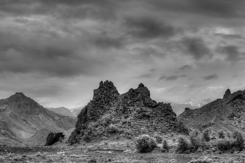 A black and white photo depicting the  rugged beauty  of the  Highlands  in  Central Iceland .