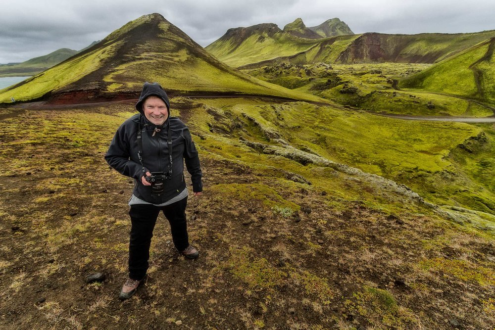 Glenn Guy , the  Travel Photography Guru , at a very windy location in the  Highlands  region of  Iceland . Photo by Tony Pepper.