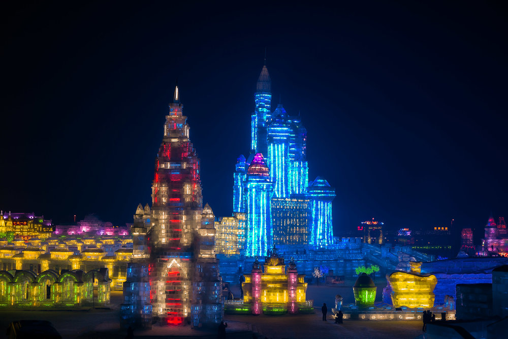 A  world of ice , illuminated by artificial light at  -20 degrees Celcius , at the spectacular  Harbin Ice and Snow Sculpture Festival  in  Harbin, China .