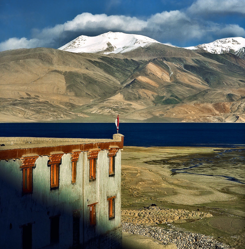 A medium format image, from the early 90's, made on a  Hasselblad 500CW camera  with a  Hasselblad 150 mm Sonnar f4 lens . A beautiful  Buddhist monastery  (i.e., gompa) in a spectacular landscape on the shores of  Pangong Tso  in  Ladakh, India .