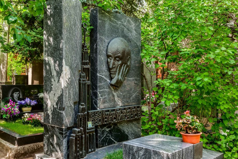 A peaceful scene of a  beautiful gravestone  in the grounds of  Novodevichy Cemetery  in  Moscow, Russia .