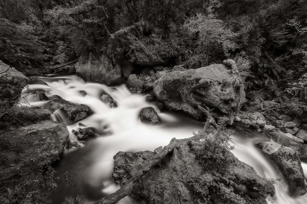A    fast flowing creek    near    Milford Sound    on the south island of    New Zealand   . I used a strong ND filter to extend the Shutter Speed and achieve the creative blur in this image.