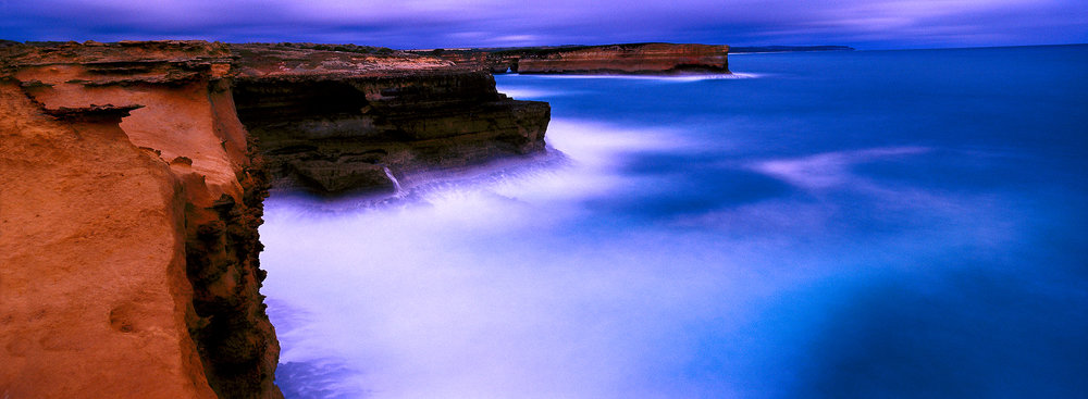This image along Australia's  Great Ocean Road  explores the notion of  duality : solidity and fluidity; rock and water; warm and cool and time passing. The image was made with a Hasselblad X-PAN II camera and a Hasselblad X-PAN 30mm f/5.6 lens.