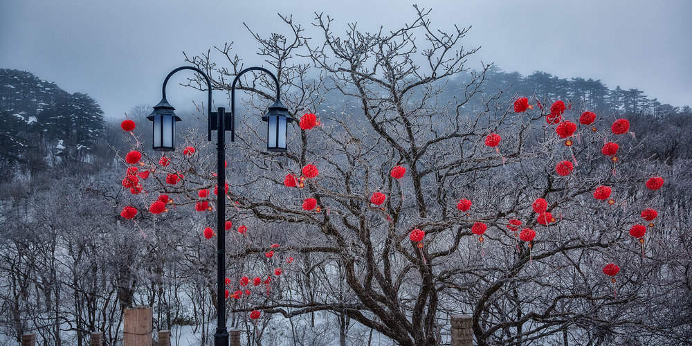 Red decorations  welcome the visitor outside a hotel on  Huangshan  (i.e., Yellow Mountain) in  China .