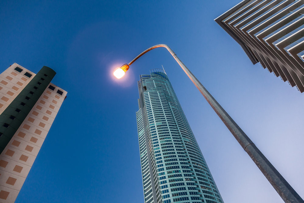 An    overhead street light    frames the iconic    Q1 Resort and Spa    at    Surfers Paradise    on the Gold Coast in    Queensland, Australia   .