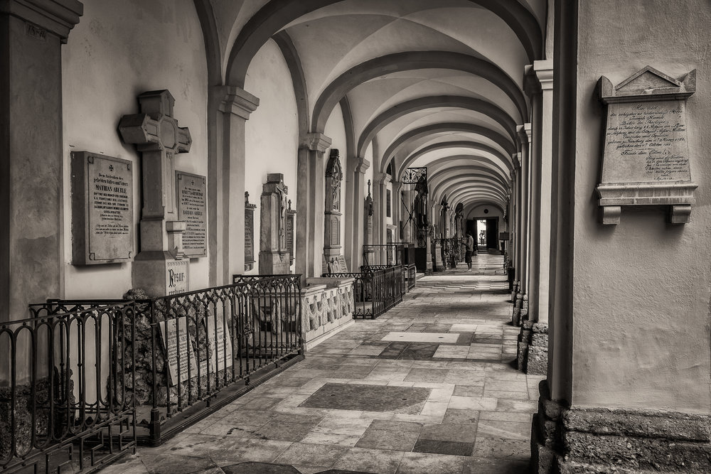 A view down a long corridor at  St. Sebastian's Cemetery  in  Salzburg, Austria .