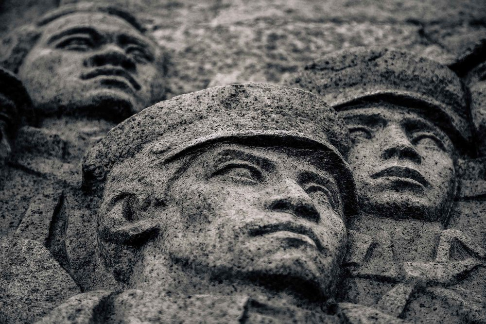 Soldiers faces , carved into stone along  The Bund  in  Shanghai, China .