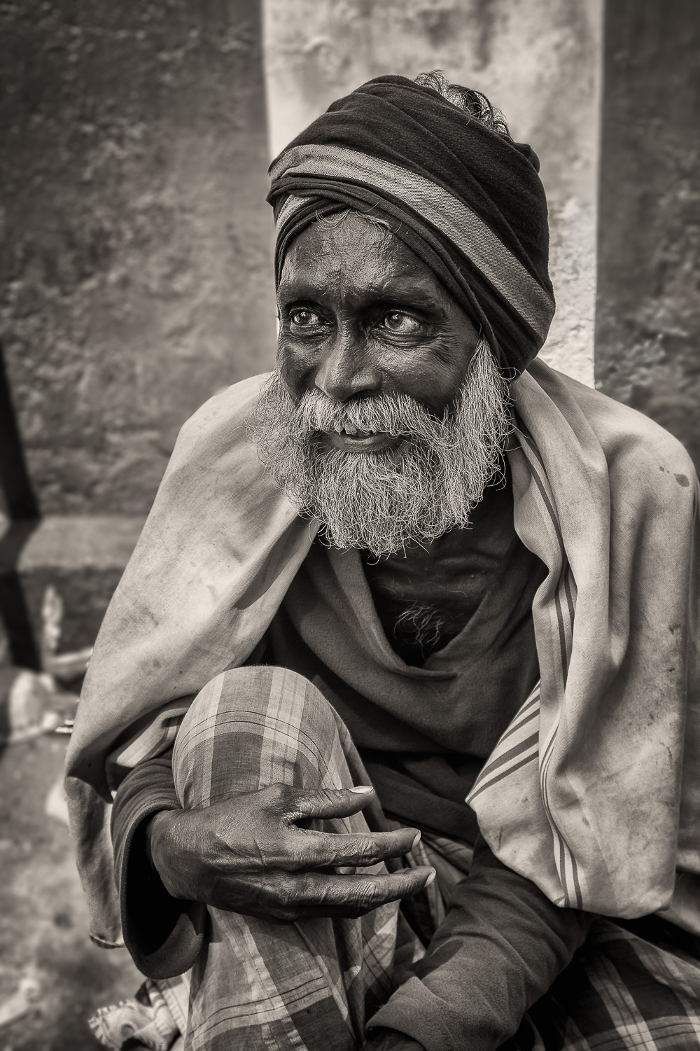 A cheeky, impish expression on the face of a  professional beggar  in  Chennai  in Tamil Nadu,  India .