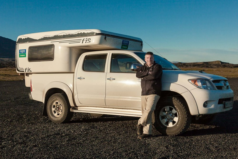Glenn Guy   , the    Travel Photography Guru   , pictured with camper van while on tour in    Iceland   .