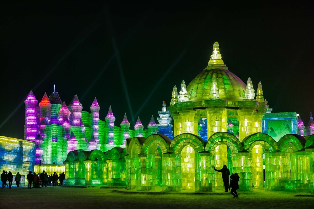 Life size ice sculptures make for surreal scenes at night at    Ice World    in the city of    Harbin, China   .