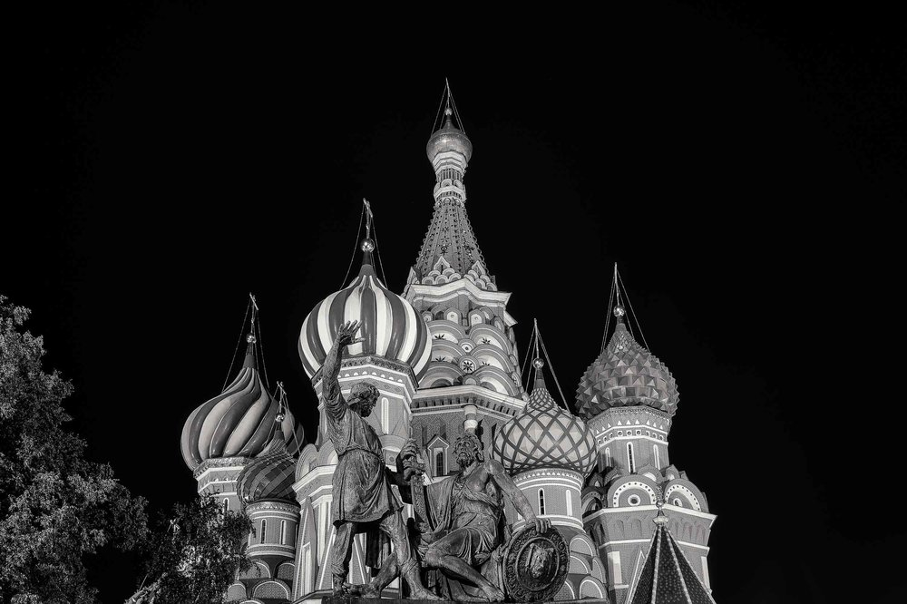 Statue of two heroes,  Minin and Prince Pozharsky , in front of  St. Basil's Cathedral  at night in  Moscow, Russia