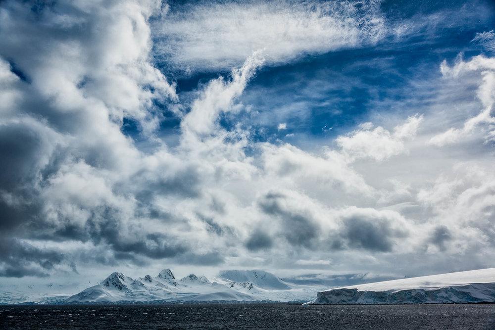 A    dramatic cloudscape    off    Cuverville Island in Antarctica   .