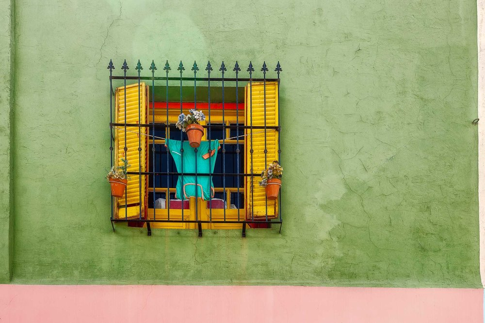 Color, shape and texture    underpin this wonderful scene of a    decorative window    surrounded by a colorful wall in the    La Boca    precinct of    Buenos Aires, Argentina   .