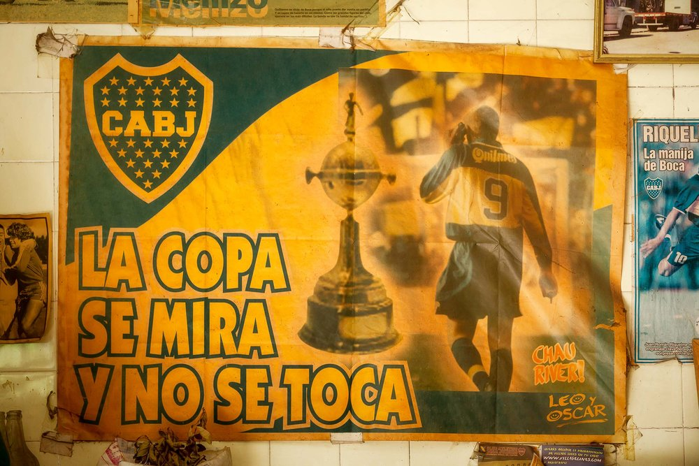 A    faded football poster    on a cafe wall in the    La Boca    tourist precinct of    Buenos Aires, Argentina   .