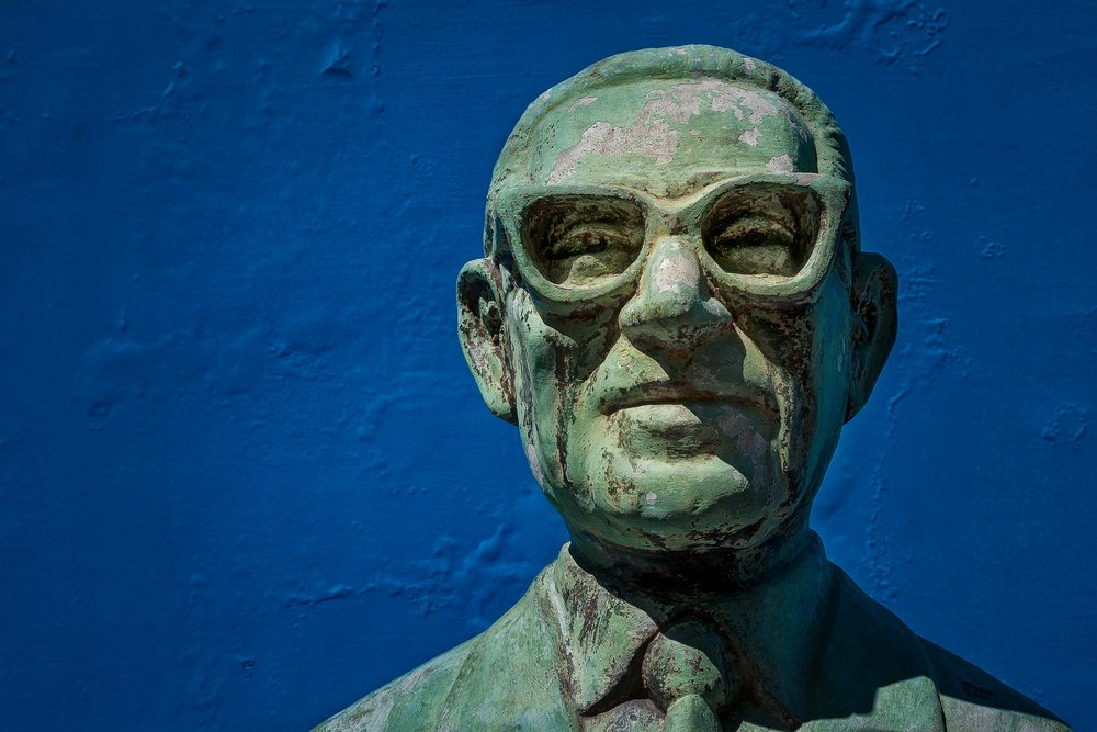 A colorful    bust of a man against a blue wall    at    La Boca    in    Buenos Aires, Argentina   .