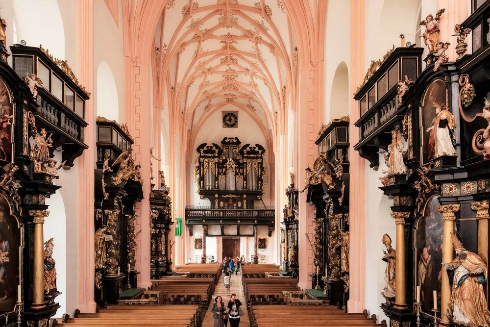 An expansive view down the aisle of the  Basilica St. Michael  in  Mondsee, Austria .