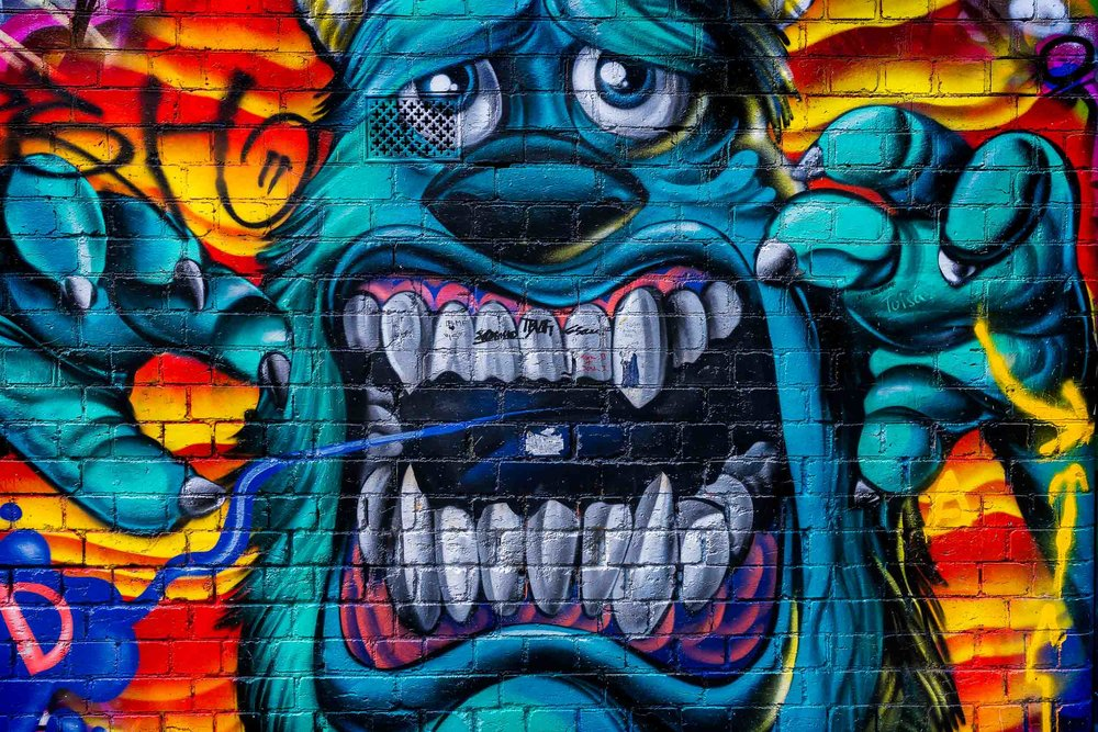 Street Art    depicting a highly detailed and    vividly colored monster    in    Hosier Lane, Melbourne   .