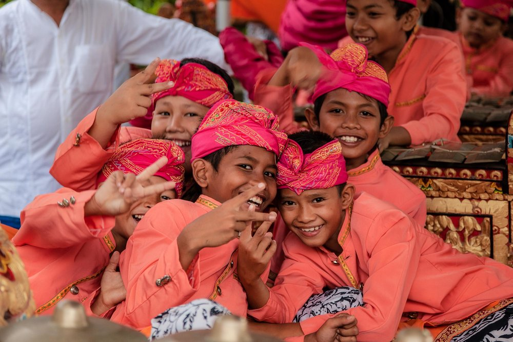 A group of    young boys    playing up for the camera at a local band practice near    Ubud    in    Bali   .