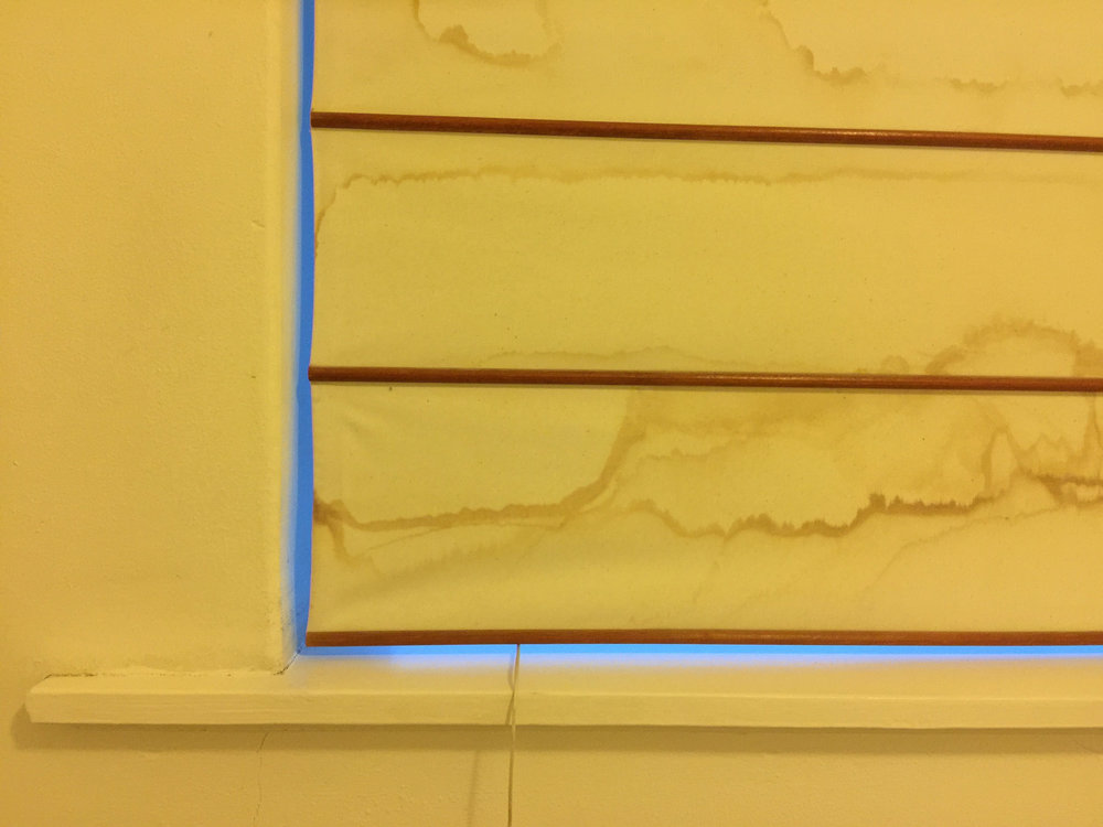 There are two distinctly different color temperatures in this scene. The fact that there is both cool    blue dawn light   , coming through the gap between the blind and window frame, and warm    yellow/orange Tungsten    (i.e., Incandescent) light preventing my old iPhone 6 plus camera's auto white balance from neutralizing the color of the light and recording the scene the way most folks would expect it to look.
