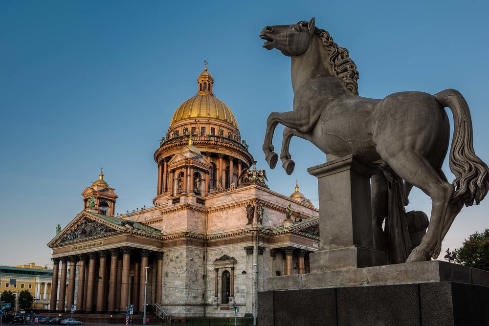A spectacular  horse sculpture  and the magnificent  St. Isaac's Cathedral ,  St. Petersburg, Russia .