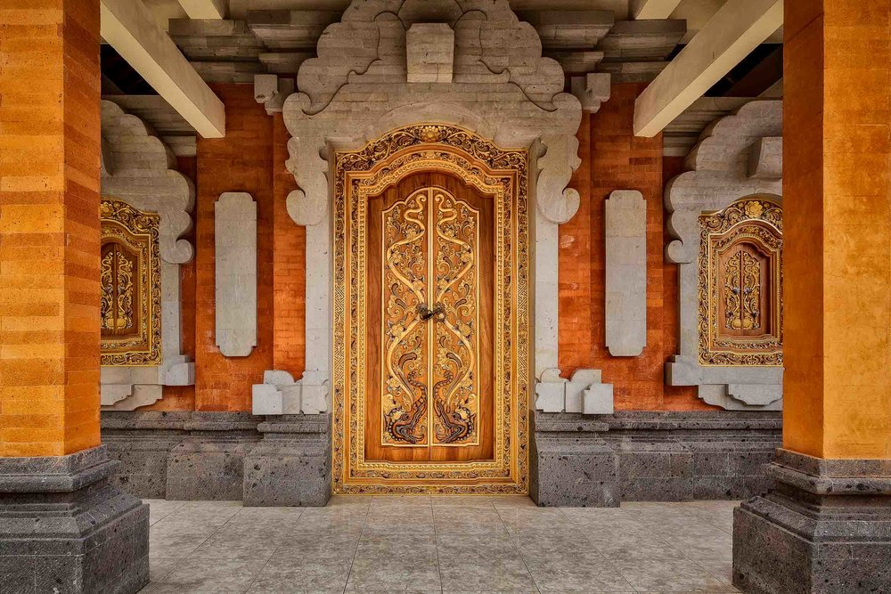 An ornate, c   olorful door    marks the entrance to a    Hindu temple    in rural    Bali, Indonesia   .