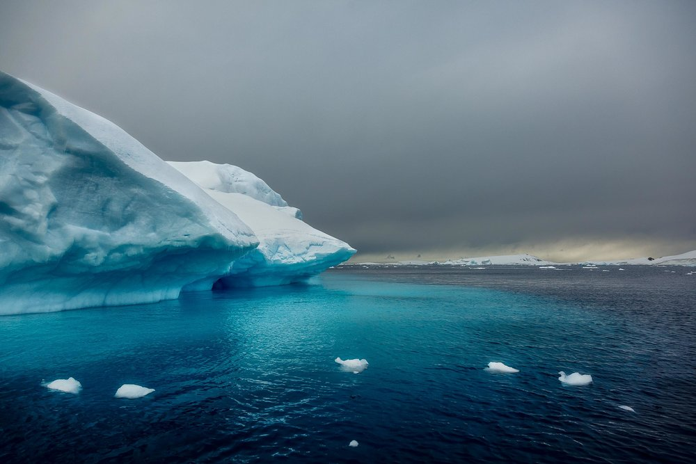 Light illuminates ice    off the coast of    Cuverville Island    in    Antarctica   .