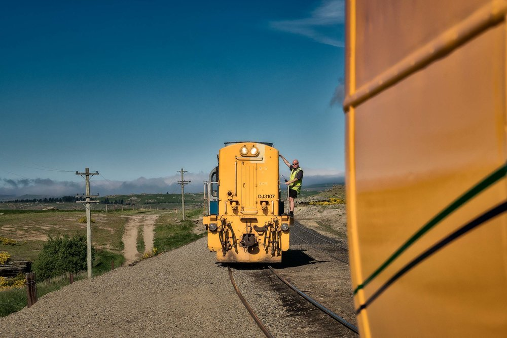 A    workman    about to    link carriages    on the    Taieri Gorge Railway    line near    Dunedin    in    New Zealand   .