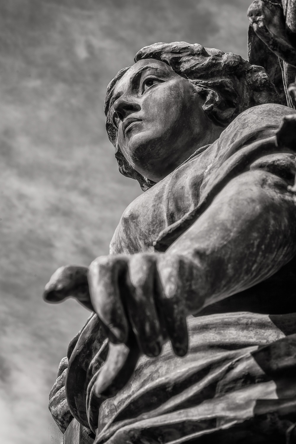 A dynamic view of a    statue    at    La Recoleta Cemetery    in    Buenos Aires, Argentiina   .