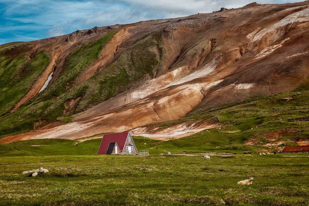 An    A-frame building    set in a geographically    stunning landscape    in rural    Iceland   .