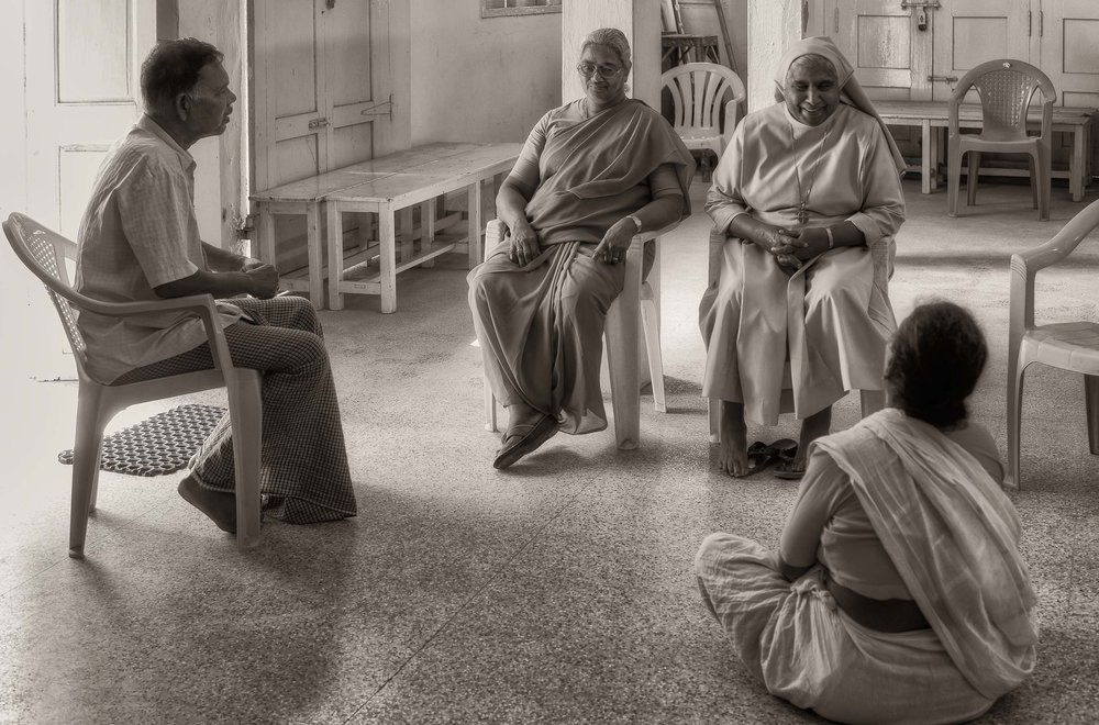 A casual conversation in the multi-purpose hall in the village of    Maria Purem   , a village named after my mother, near    Chennai, India   .